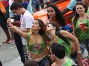Brazilian girls taking a selfie on an iPhone during Carnaval 2014