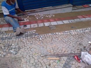 Paver setting the stones, brick-by-brick