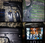 A Rio de Janeiro's tools of the trade: a gun, a bullet-proof vest and a mobile phone.