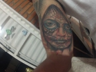 Candy skull tattoo on bicep