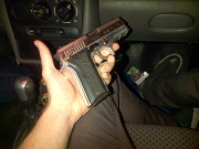 Police-issue hand-gun in the car on the way to the nightclub