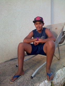 13-year-old Brazilian kid with tattoos along his forearms
