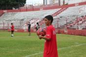Little Brazilian kid in a Coca-Cola sponsored soccer jersey