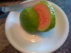 Guayaba fruit, sliced open to reveal its sweet pink flesh
