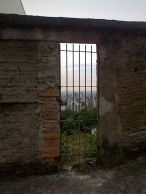 View of the city of Belo Horizonte from Mirante, Mangabeiras through an abandoned gate