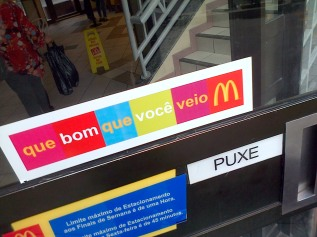 """Que bom que voce veio!"" - ""How nice that you came here!"" - sign outside a Mcdonalds in Brazil."