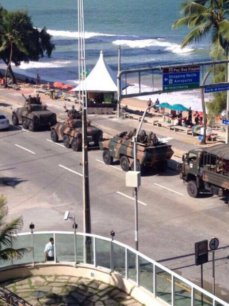 Tanks line the streets next to the beach in Recife with the police on strike