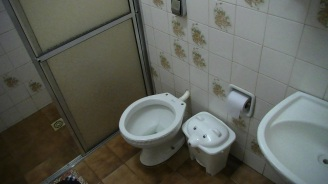 Note there is no toilet seat and a waste-paper bin for used toilet-paper