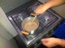 Warming up leite condensado in a pan to make Brigadeiros.
