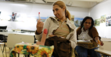 A prostitute in Belo Horizonte, Brazil attending an English class