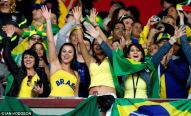 Hot Brazilian girls cheering Brazil on in the stadium World Cup 2014